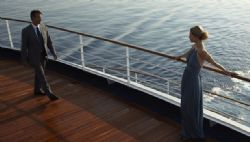 Lifestyle - Elegantly dressed couple meeting on deck